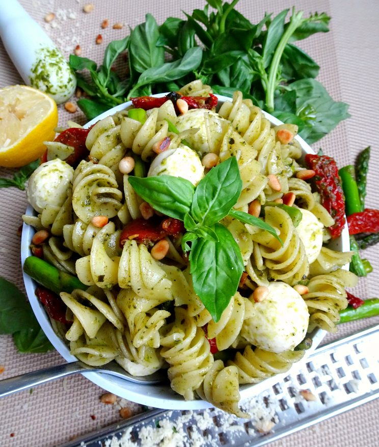The ultimate 10 minute Pesto Pasta with Asparagus and Sun Dried Tomato aerial view with decorative surrounding