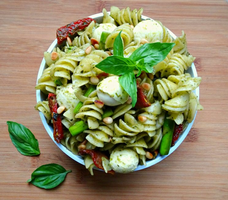 The ultimate 10 minute Pesto Pasta with Asparagus and Sun Dried Tomato Aerial View on chopping board