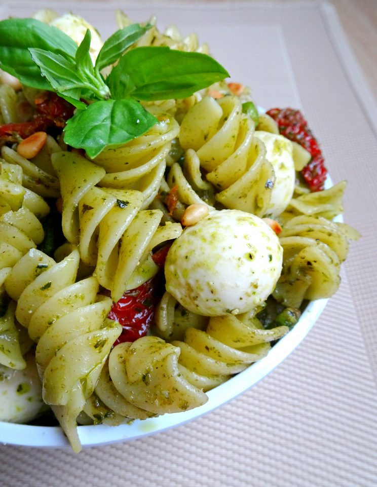 The ultimate 10 minute Pesto Pasta with Asparagus and Sun Dried Tomato Close up on Basil Leaf