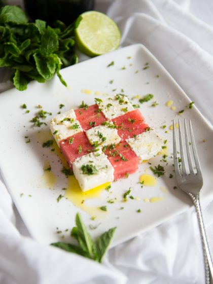 Watermelon and Feta Salad cubes with mint and fork