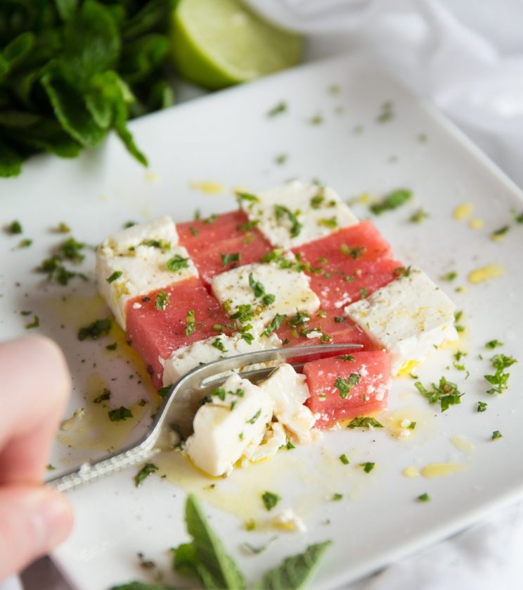 Watermelon and feta salad with mint - slicing with fork