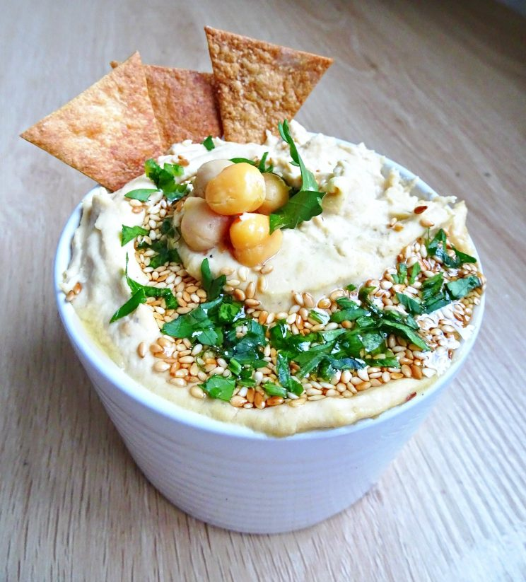 Toasted Sesame Hummus - full garnish with tortilla chips