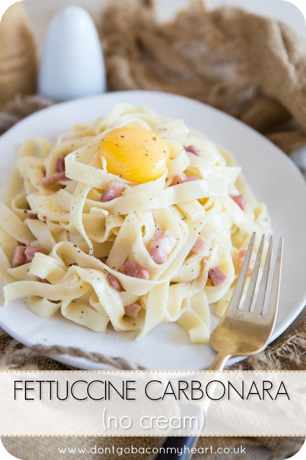 Inspired by a classic carbonara recipe, this Fettuccine Carbonara No Cream is served with an egg yolk for a rich and delicious modern twist! #pasta #carbonara #fettuccine | www.dontgobaconmyheart.co.uk