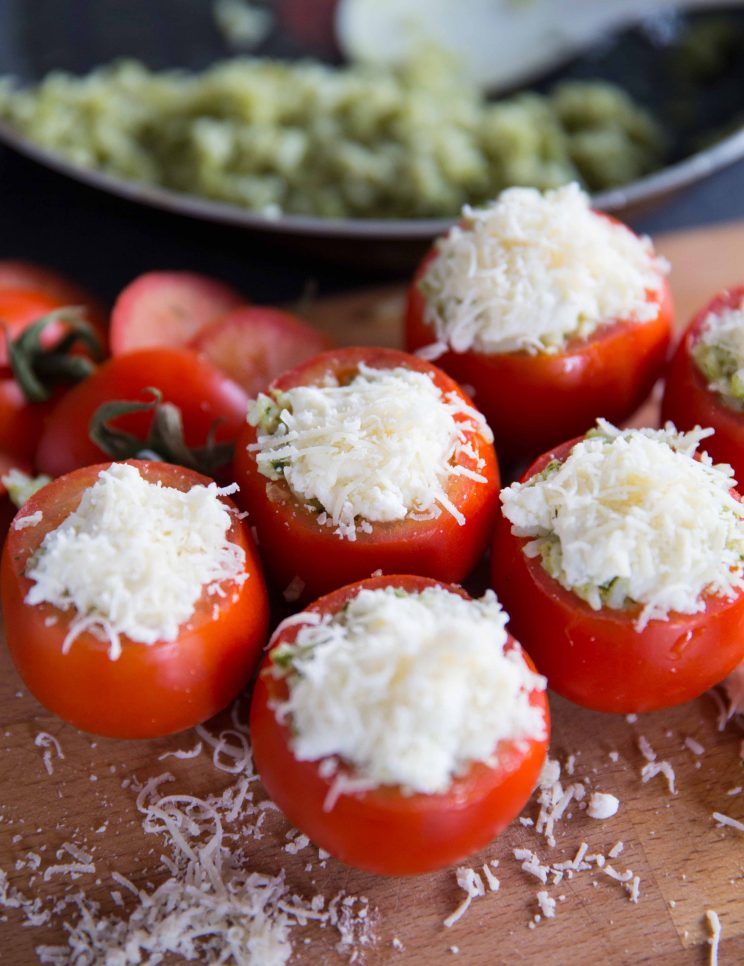 Cheesy Pesto Rice Stuffed Tomatoes - Topped with Parmesan