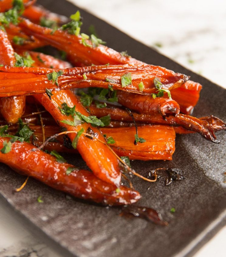 closeup shot of carrots on serving dish garnished with parsley