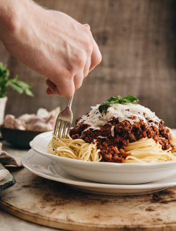The Best Spaghetti Bolognese Recipe - Twisting Spaghetti with Fork