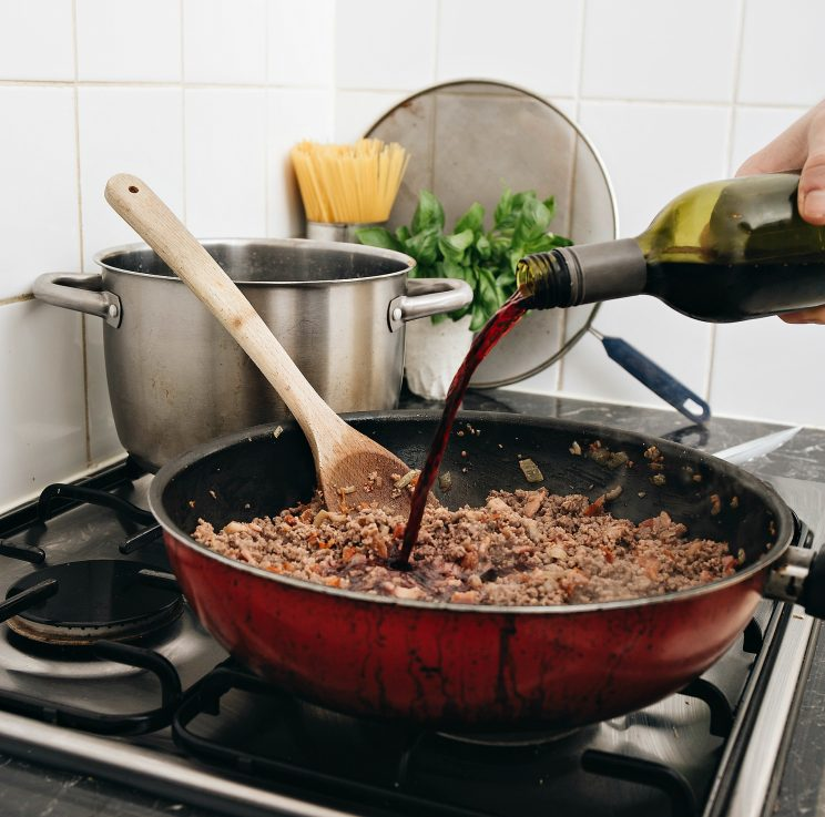 The Best Spaghetti Bolognese Recipe - Wine Pouring in