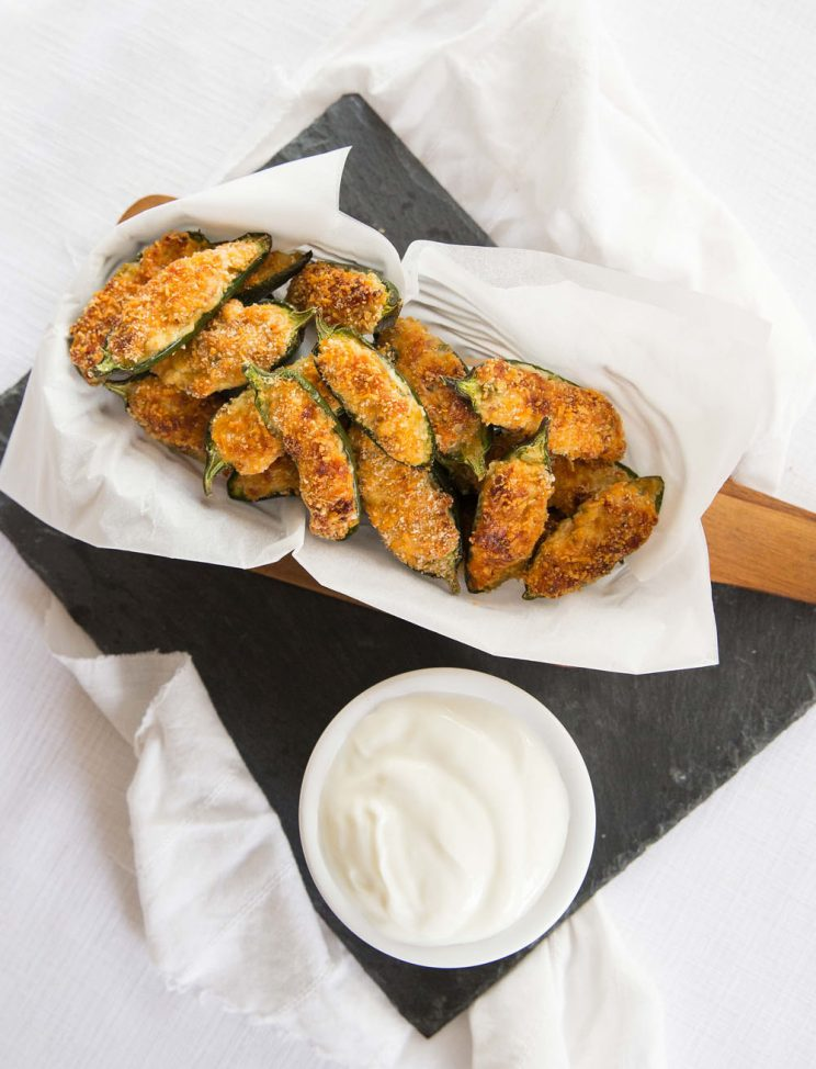 Crispy Baked Jalapeño Poppers in a basket with sour cream