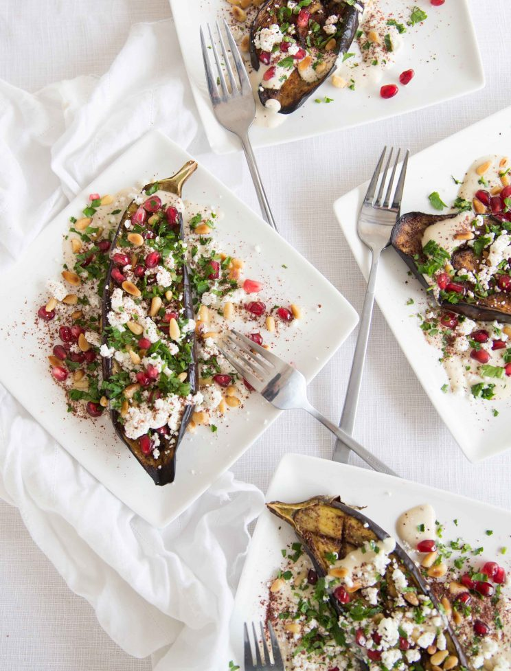 Roasted Eggplant with Tahini Yogurt Sauce and Pomegranate served on 4 plates