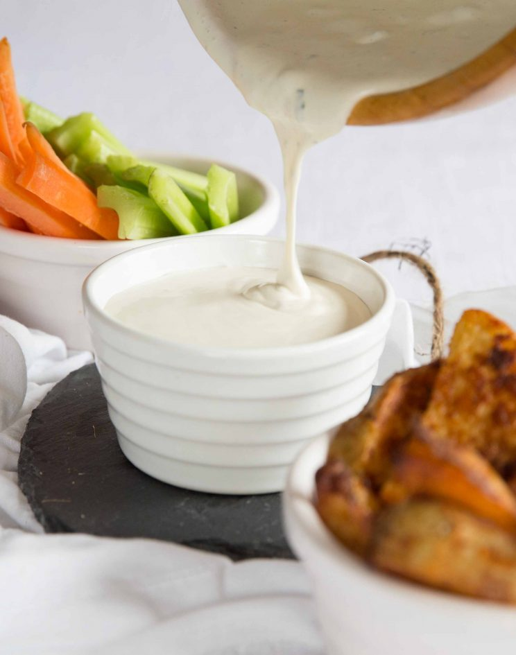 blue cheese dip pouring into dipping bowl