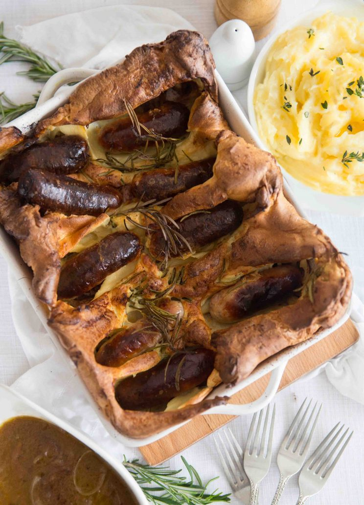 overhead shot of Toad in the Hole with Dijon Mash Potato and Red Wine Onion Gravy