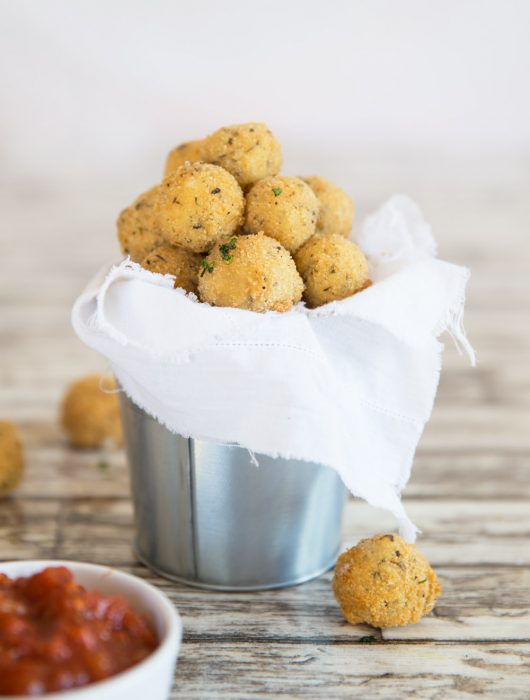 Fried Cheese Balls in a bucket with marinara dip