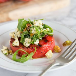 Grilled Watermelon Salad with arugula, blue cheese and pistachios