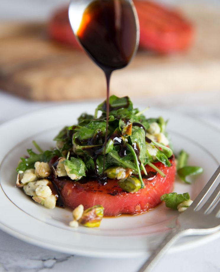 Grilled Watermelon Salad with Balsamic Glaze being poured on top