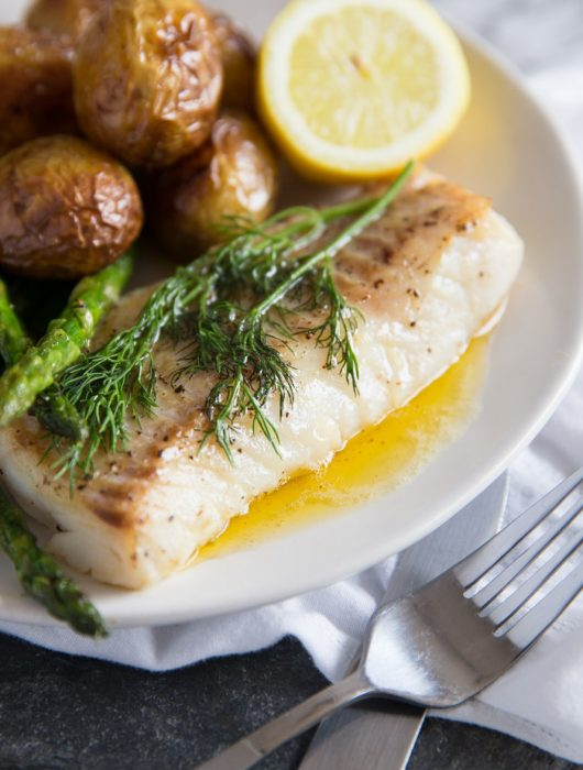 Pan Fried Cod with brown butter sauce, new potatoes, lemon and asparagus