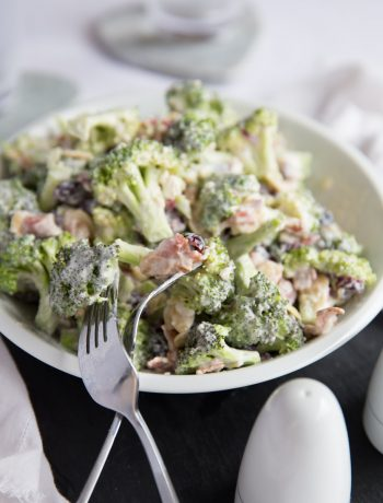 Crunch Broccoli Salad with Bacon served in a bowl with two forks