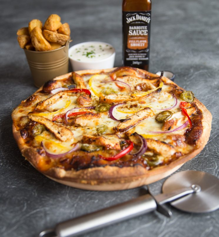 bbq chicken pizza with dip, wedges, bbq sauce and pizza cutter