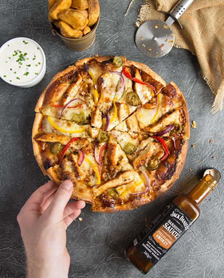 Smokey BBQ Chicken Pizza overhead with wedges and sour cream and chive dip