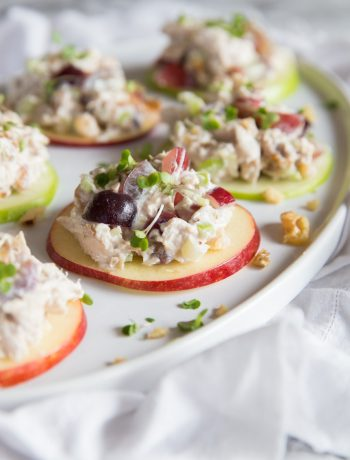 Chicken Waldorf Salad Bites served on apple slices with toasted walnuts