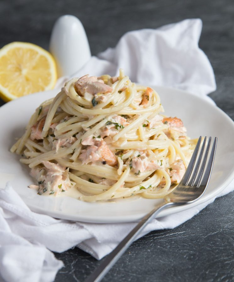 Salmon Pasta in a Creamy Dill Sauce with salt and lemon in the background