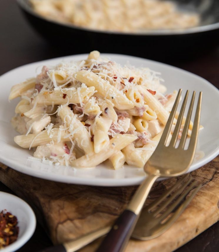Rotisserie chicken and bacon pasta served with extra chilli flakes