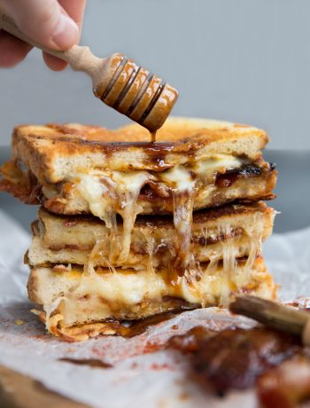 Grilled Cheese with honey dipper pouring over sauce