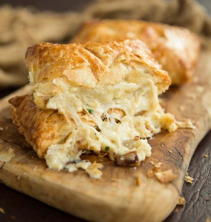 Cheese pouring out of greggs copycat cheese and onion pasty