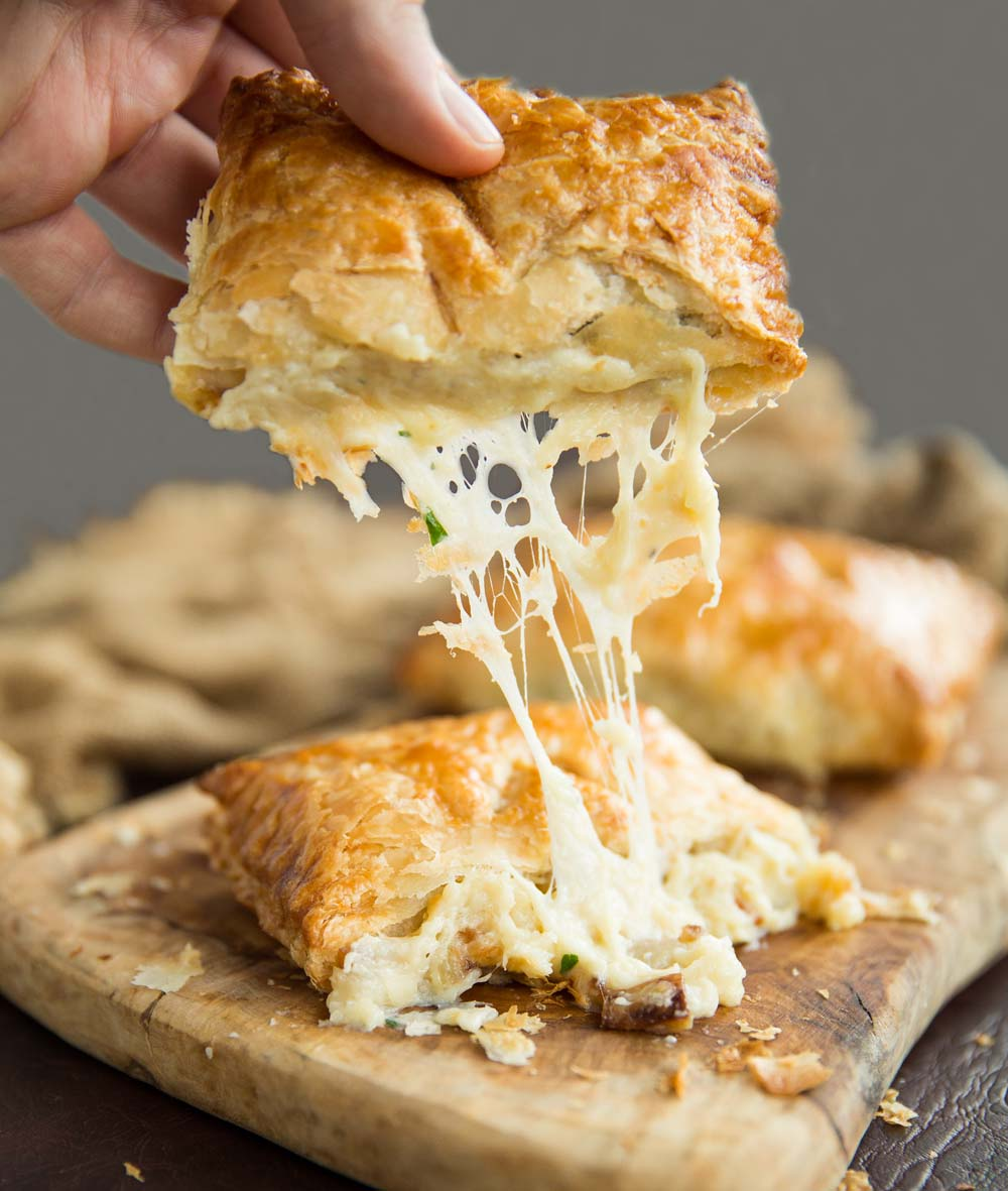 Cheese onion and potato pasties - cheese pull