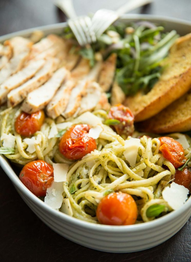 Avocado Chicken Pasta closeup with garlic bread and salad