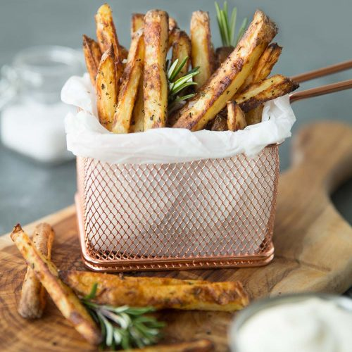 Crispy Oven Baked Fries with dip, fresh rosemary and sea salt