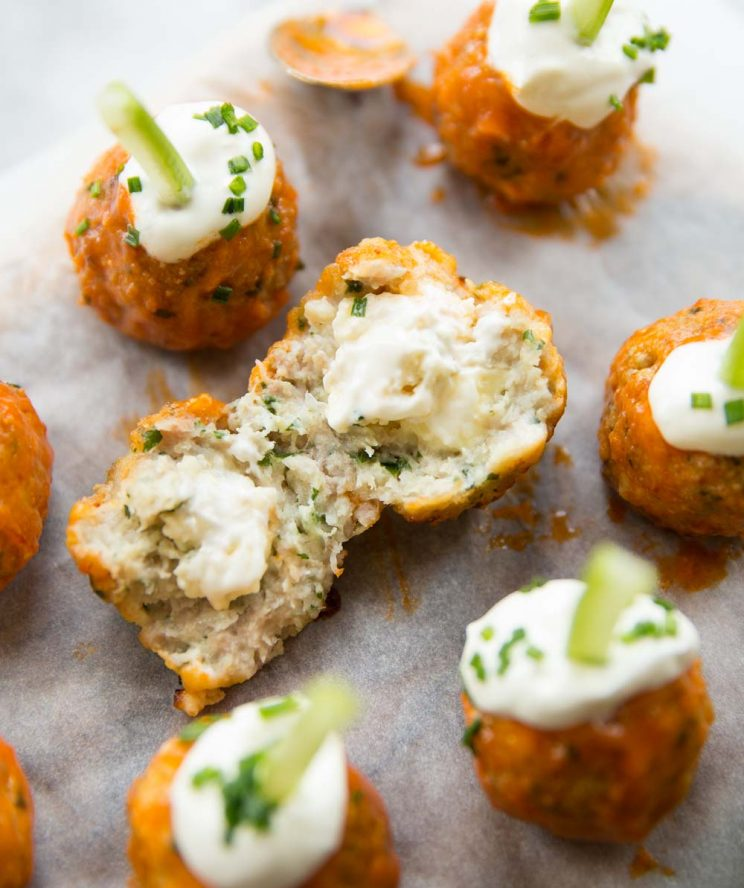 buffalo chicken meatball torn open with blue cheese pouring out
