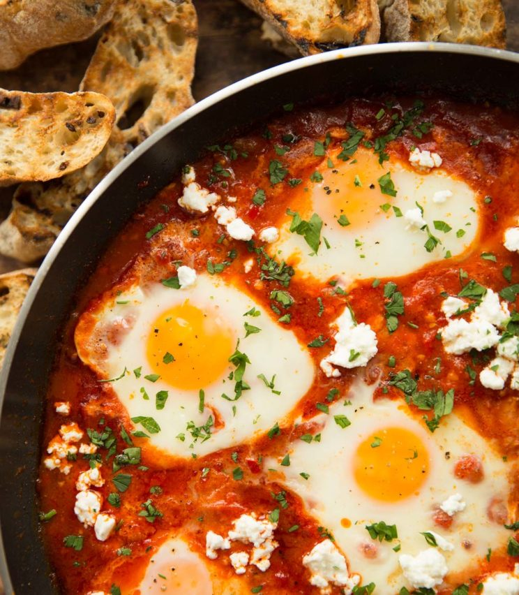 close up of shakshuka garnished with feta and parsley