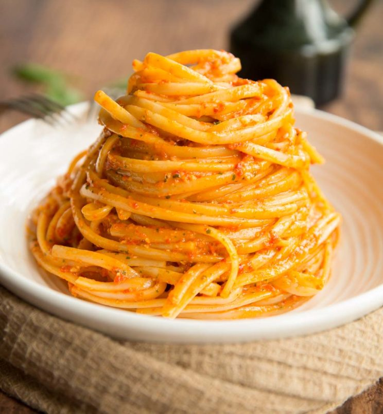 Roasted Red Pepper Pesto Pasta plated up on white plate
