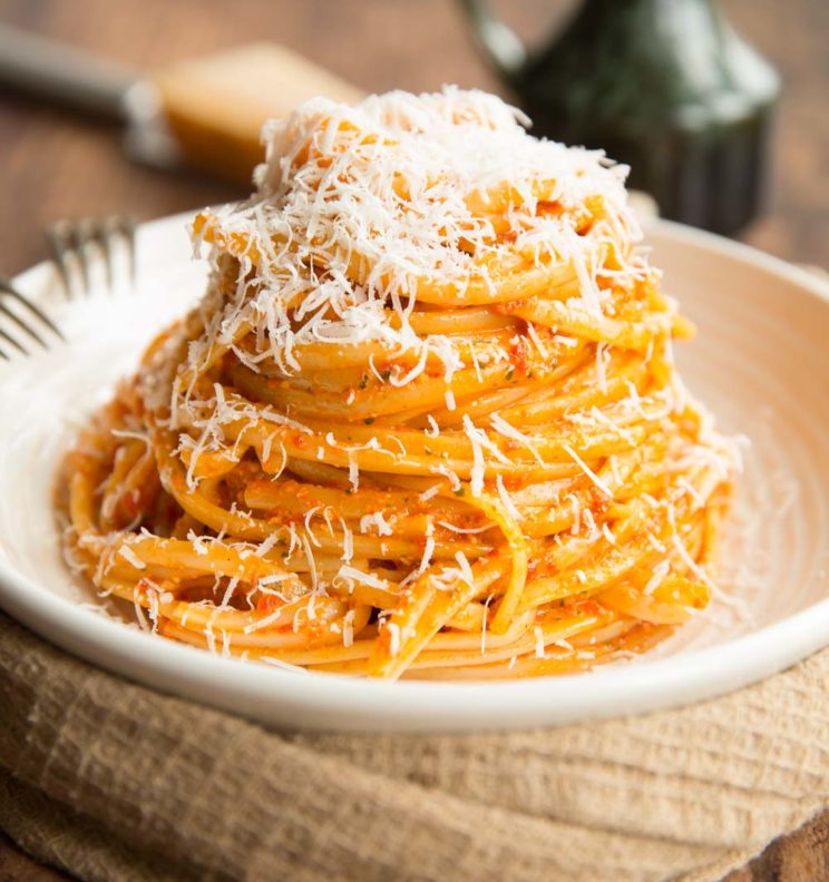 Roasted Red Pepper Pesto Pasta served on white plate with extra parmesan
