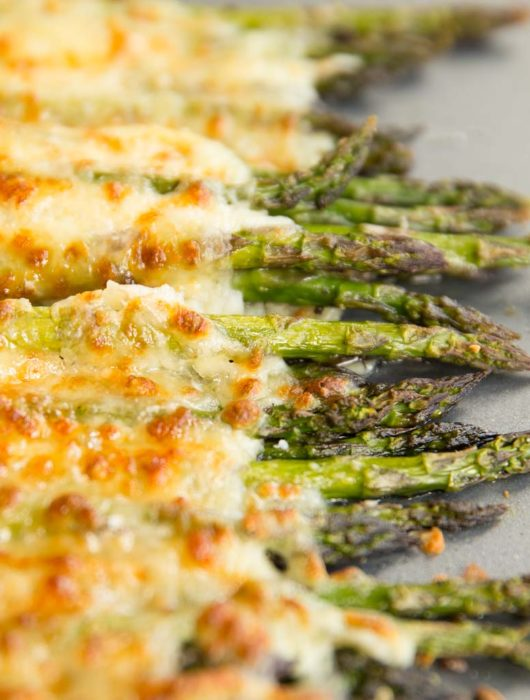 cheesy asparagus fresh out the oven on silver baking tray