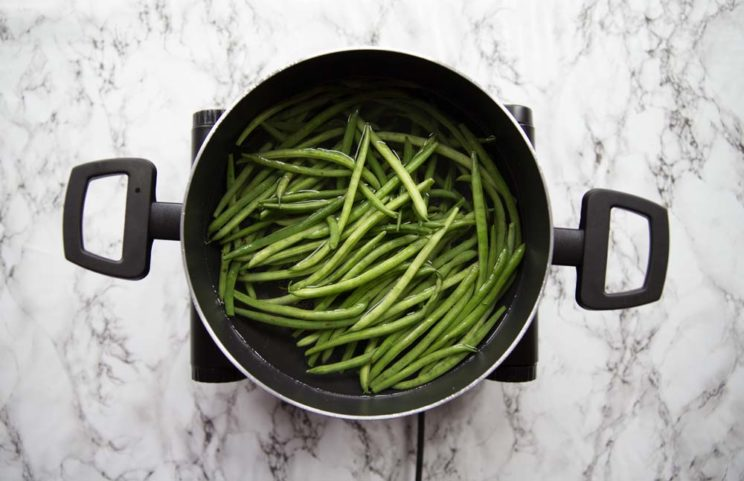green beans in a pot of water ready to boil