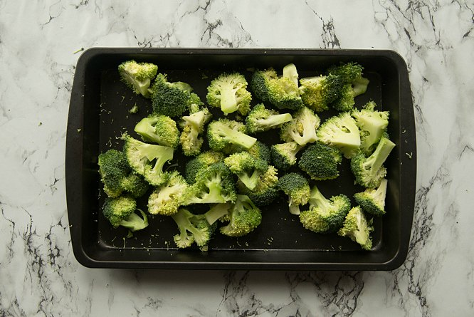 overhead shot of broccoli on tray ready for roasting