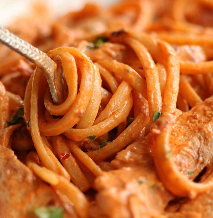 closeup shot of pasta twizzling around fork