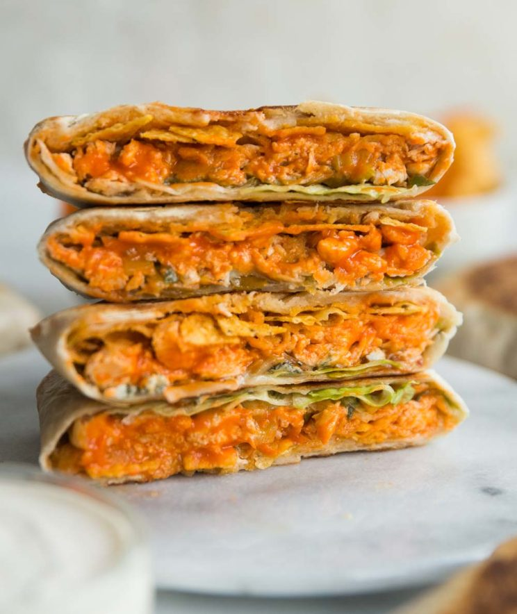 crunchwraps stacked on top of each other on marble board