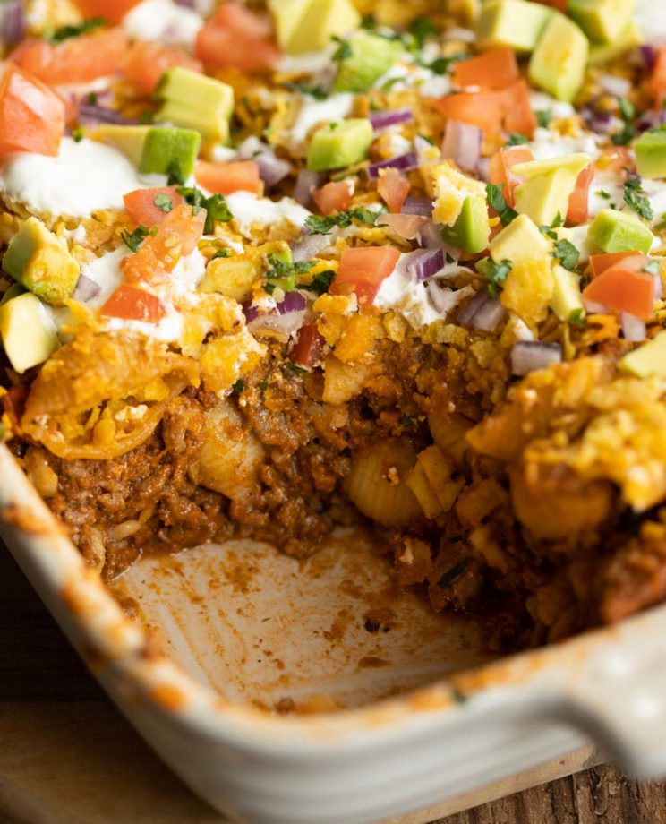 closeup shot of taco pasta in casserole dish with portion scooped out