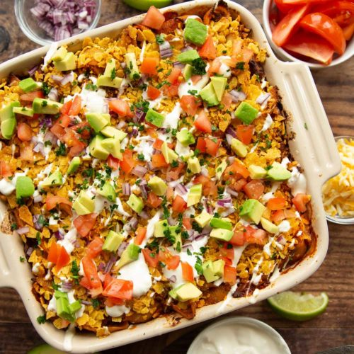 overhead shot of taco pasta with taco ingredients on top in casserole dish