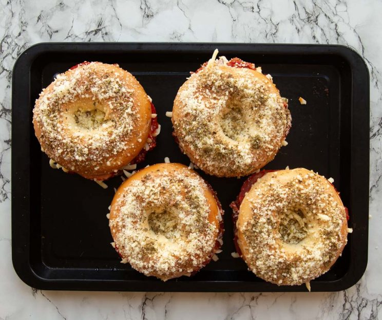 over head shot of bagels on baking tray ready to go in oven
