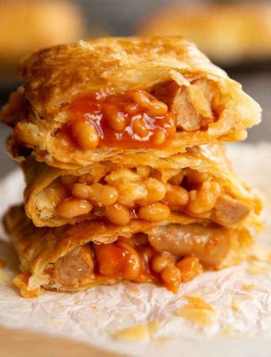 3 slices stacked on each other with beans spilling out
