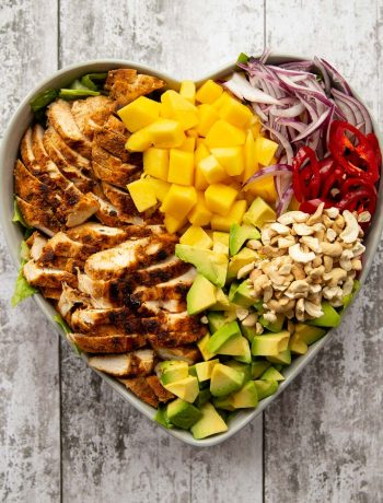 overhead shot of salad served in a heart shaped bowl