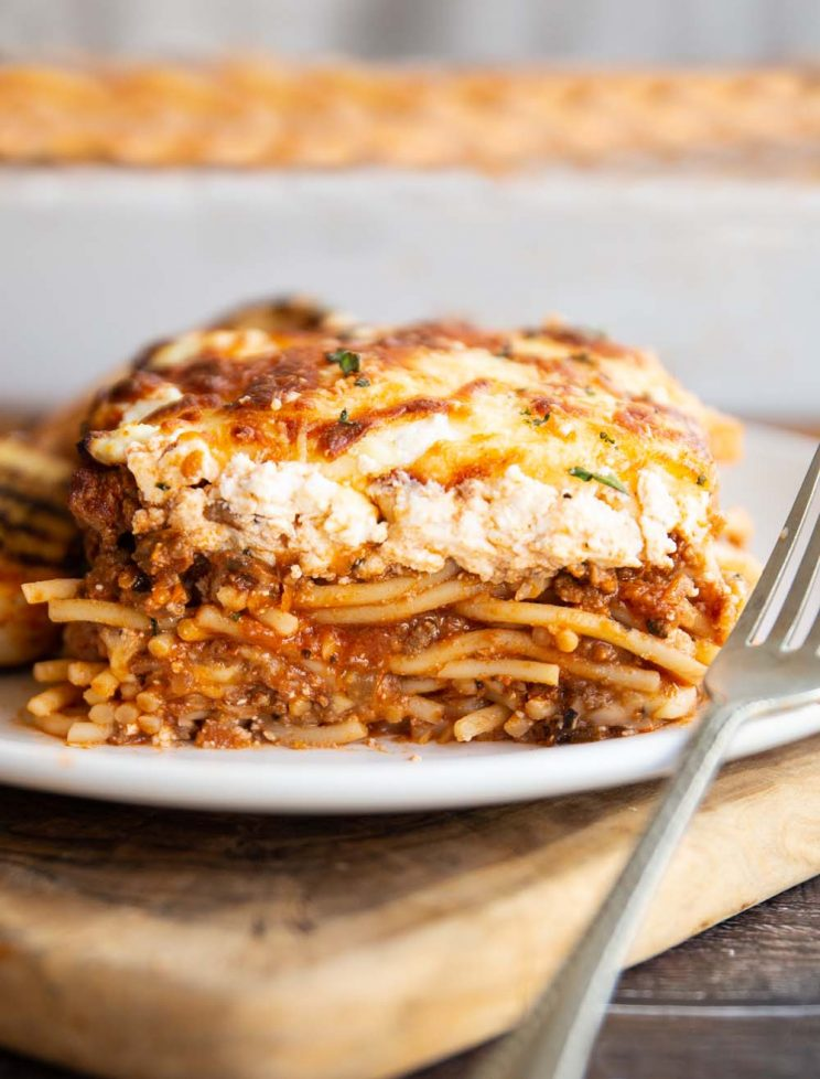 spaghetti bake served on white plate with silver fork resting on it