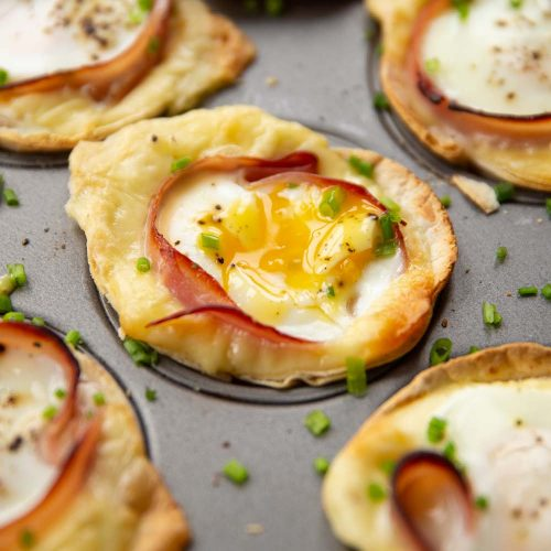 closeup shots of egg cups in muffin tin garnished with chives