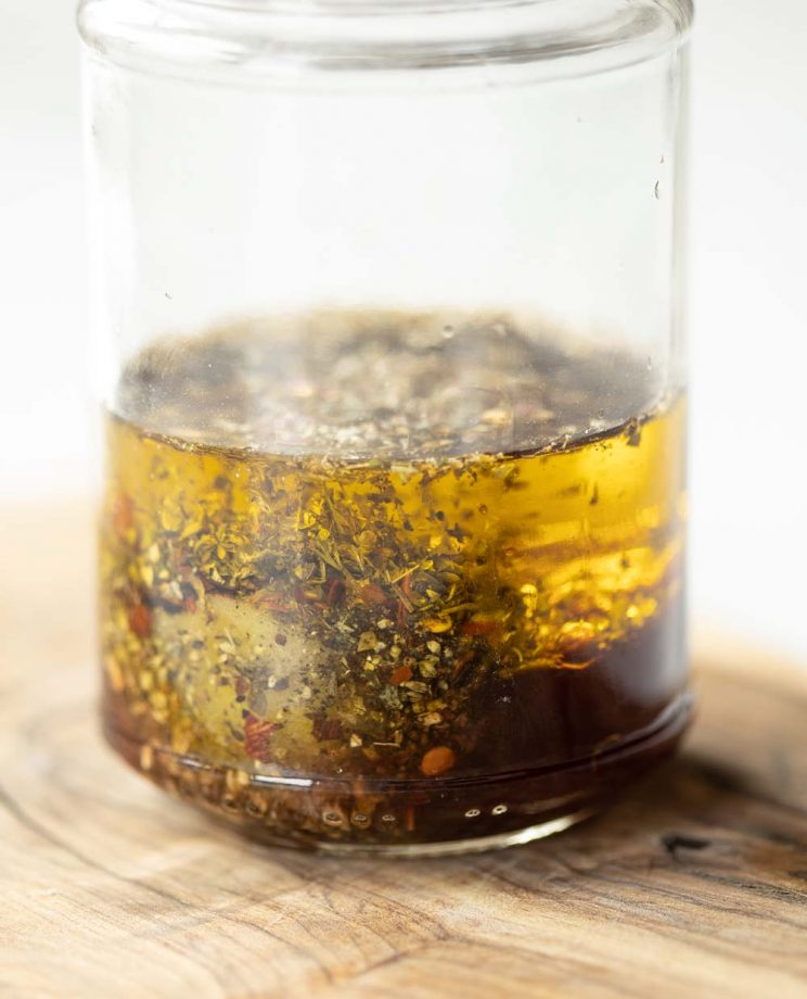 glass jar with Italian dressing inside