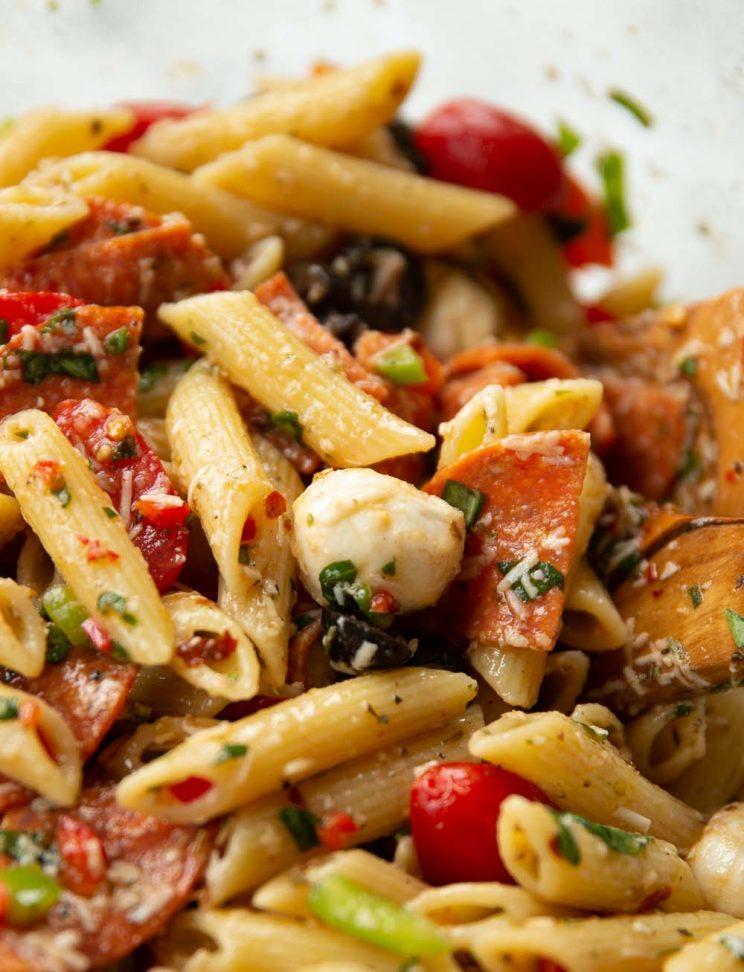 closeup shot of mozzarella ball in pasta salad