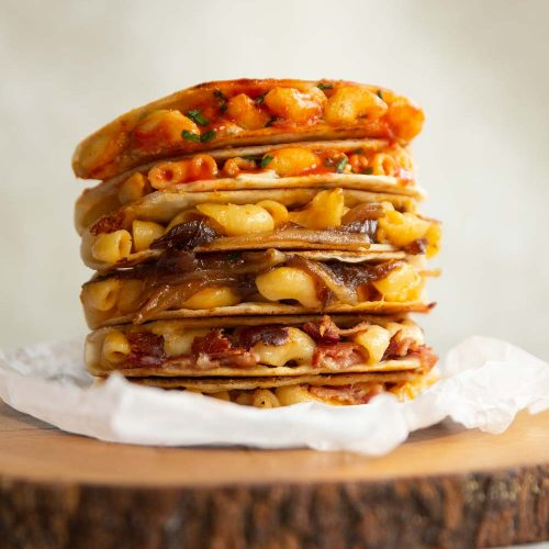 6 quesadillas stacked on each other on wooden block