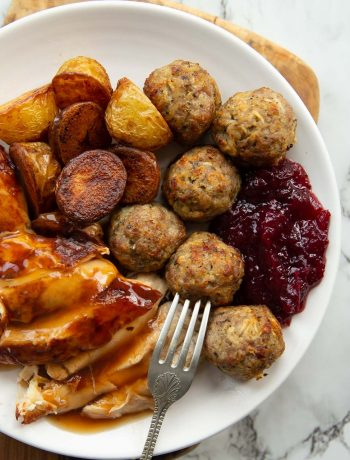 overhead shot of small roast dinner on white plate with stuffing balls